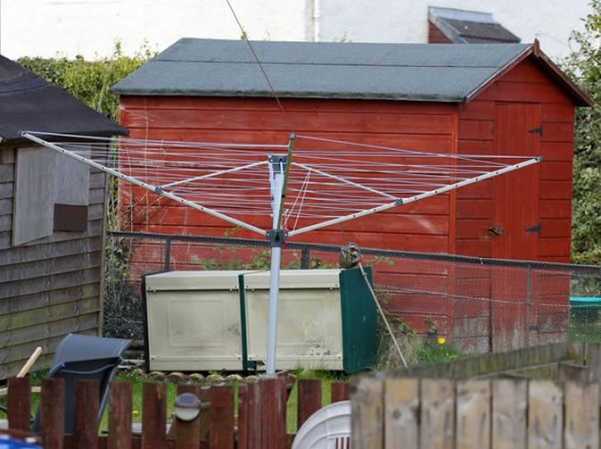 Woman stabbed after refusing to remove washing line to let neighbour's son play football