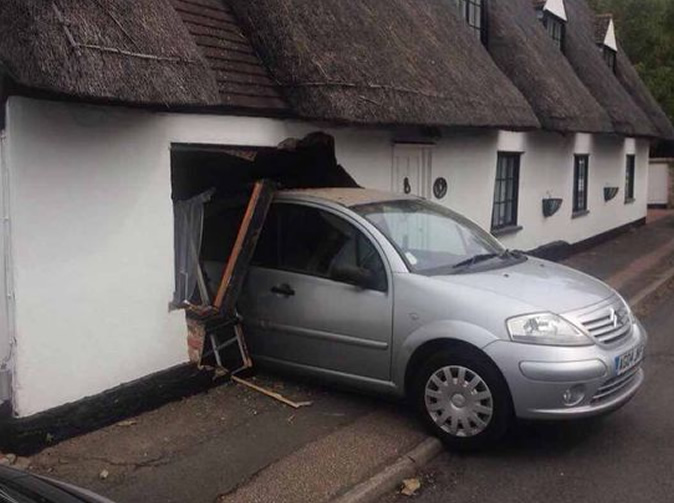 Motorist reverses into picturesque cottage