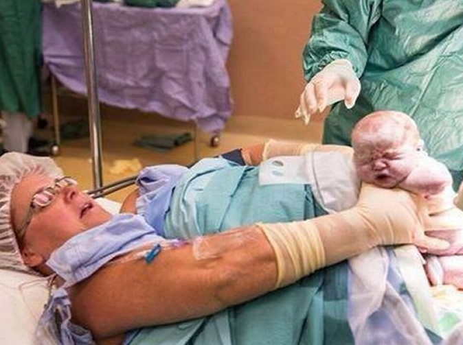 Woman helps deliver her own babies during caesarean section