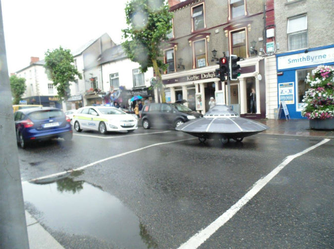 Police car chases flying saucer down street