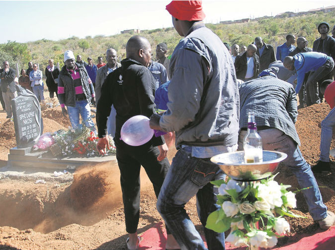 Mourners blow up condoms at funeral