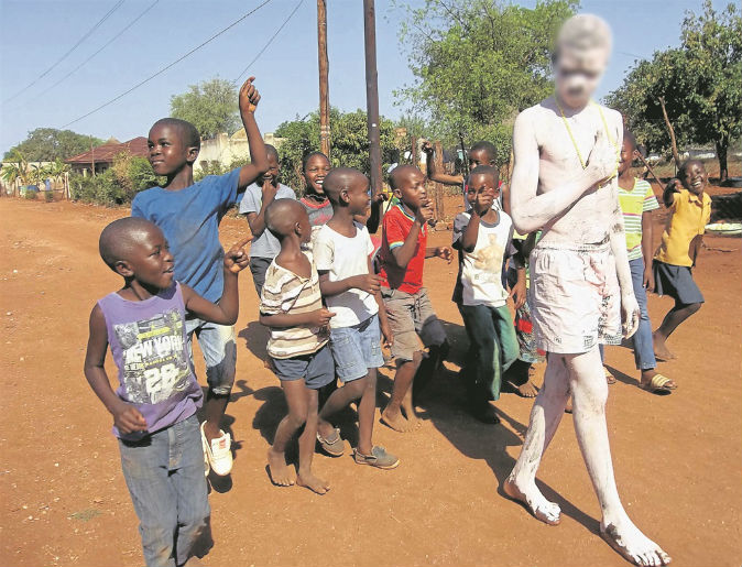 'Thief' painted white, forced to walk down the road