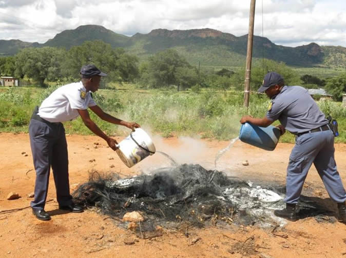 Cop necklaced with burning tyre