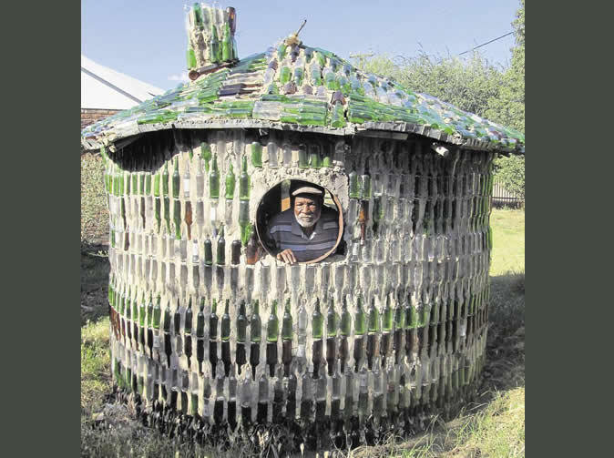 Man builds house with booze bottles