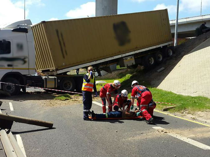 Heavily pregnant woman pinned beneath large tipper truck