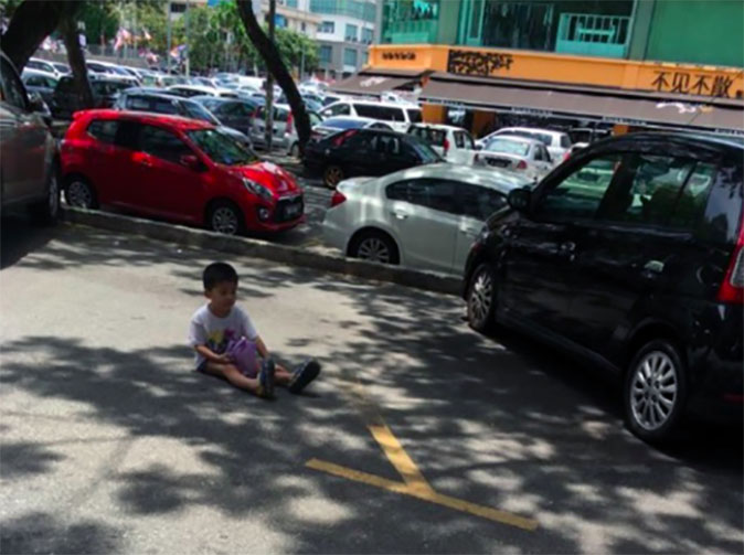 Mother uses toddler to reserve parking space