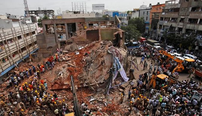 Building collapses in India, kills at least 12