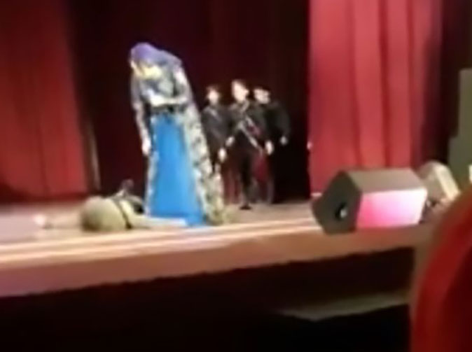 Audience clap and laugh as dancer collapses and dies on stage