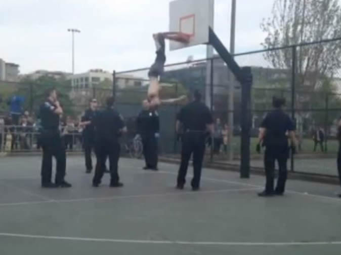 Man found hanging upside down from basketball hoop