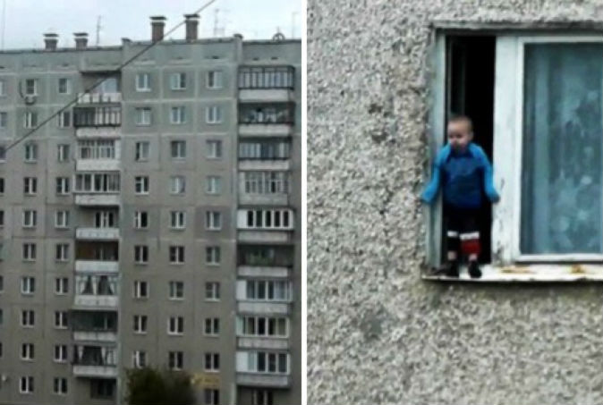 Toddler inches away from fall as he casually stands on window ledge of 8th-floor flat