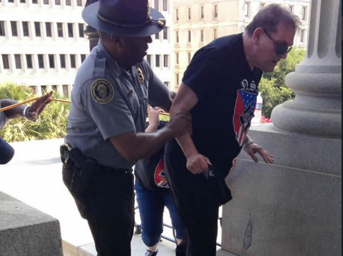 Black cop assists white supremacist, photo goes viral