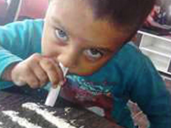 Fury as toddler, 3, appears to snort cocaine in shocking photo