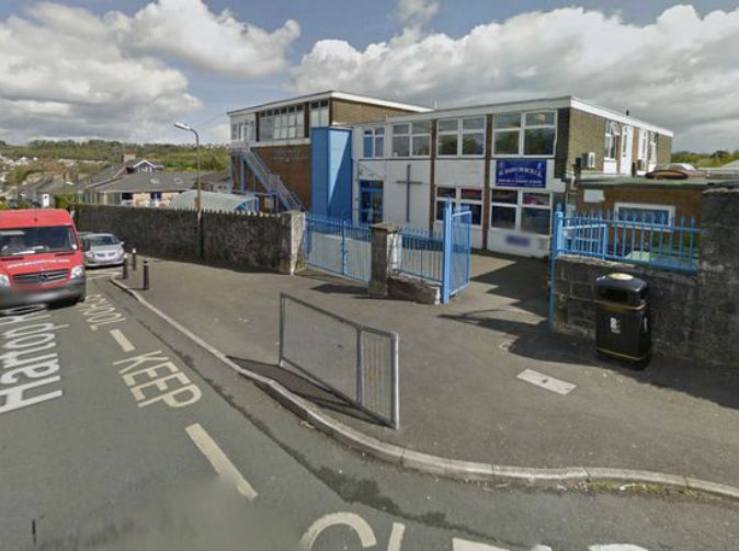 Woman 'battered with a hammer' outside primary school
