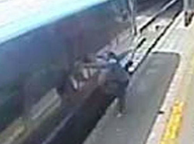 Woman dragged 20 metres along station platform after train door clamped shut on her hand