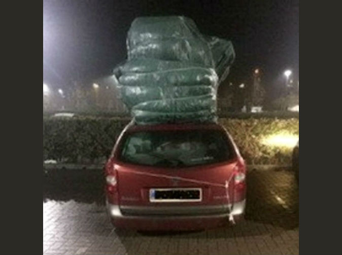 Driver banned after overloading car it nearly as tall as double decker bus