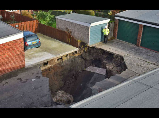 6m sinkhole opens up on residential street