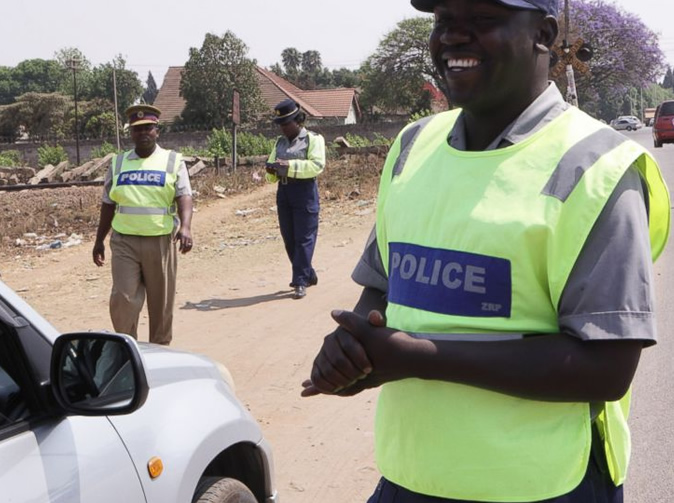 Zimbabwe 'training cops to smile more'