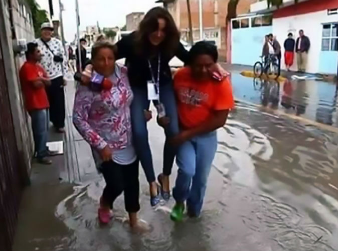 Reporter fired for letting flood victims carry her so she didn't get expensive shoes wet