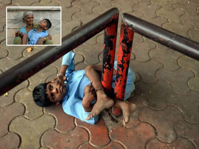 Boy left chained to bus stop so grandmother can go to work