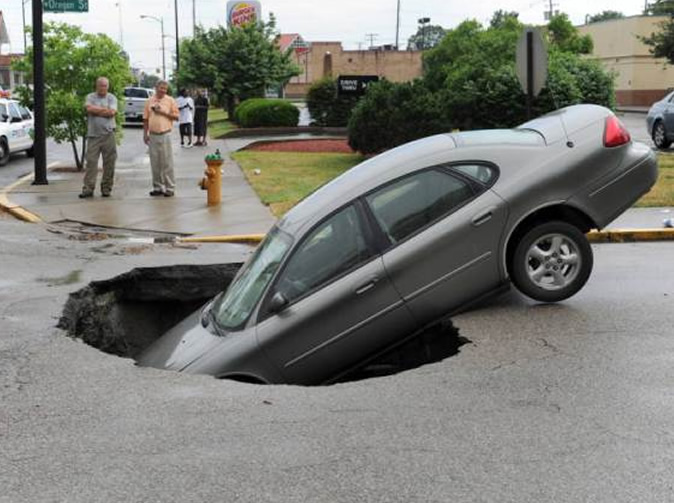Family in shock after car collapses into sinkhole