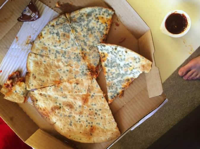 Man revolted to find mould covering base of his takeaway pizza