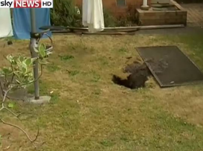 Woman swallowed by sinkhole while hanging out washing