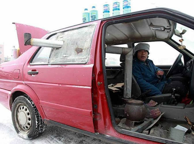 Inventive woman installs stove in car to keep warm