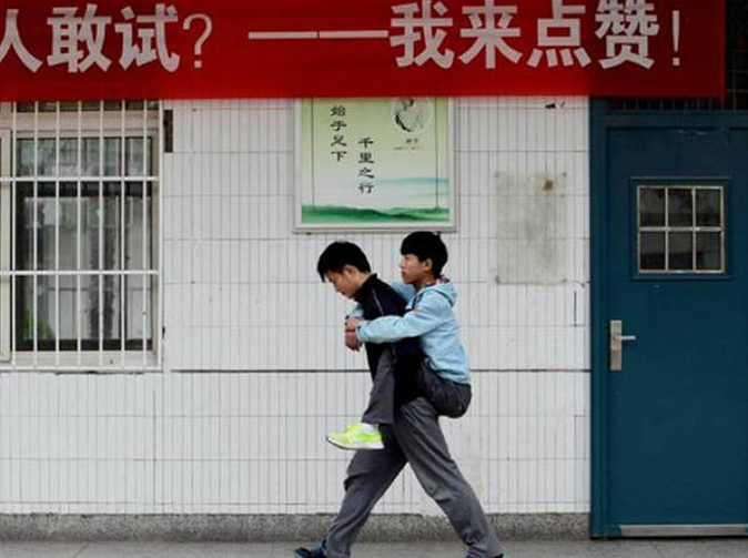 Kind student gives disabled friend daily piggybacks to class