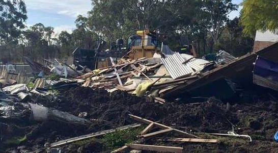 Man 'steals' bulldozer and ploughs house down