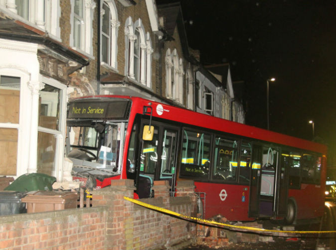 London bus crashes into woman's living room