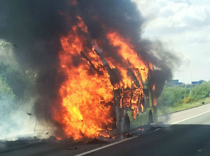 Bus full of schoolchildren bursts into flames on motorway