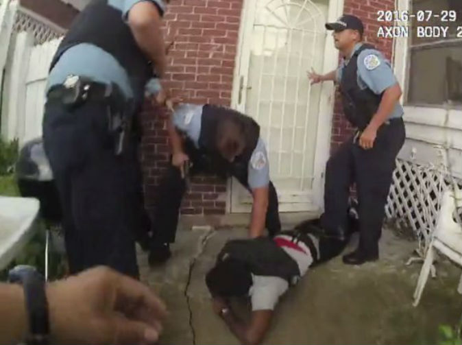 Unarmed black teenager put in handcuffs as he lay dying from gunshot wound