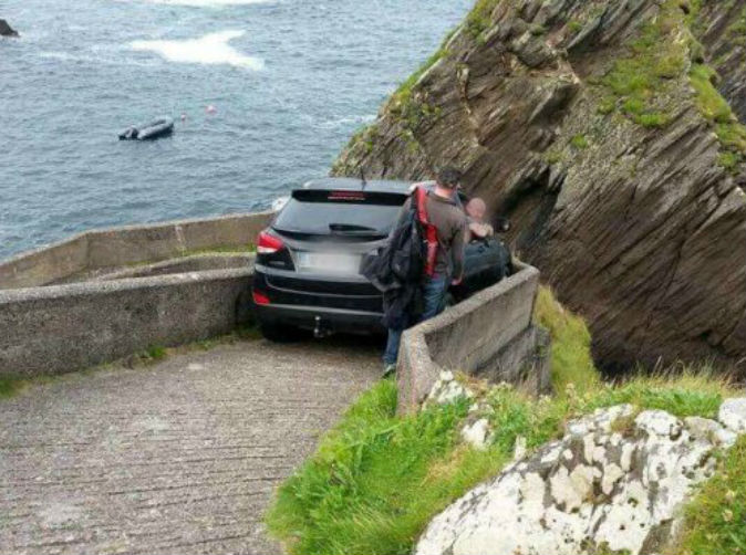 Driver stuck for 12 hours on cliff top after going down walkway