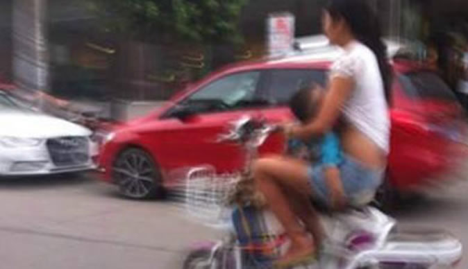 Mother in trouble for breastfeeding while speeding on bike