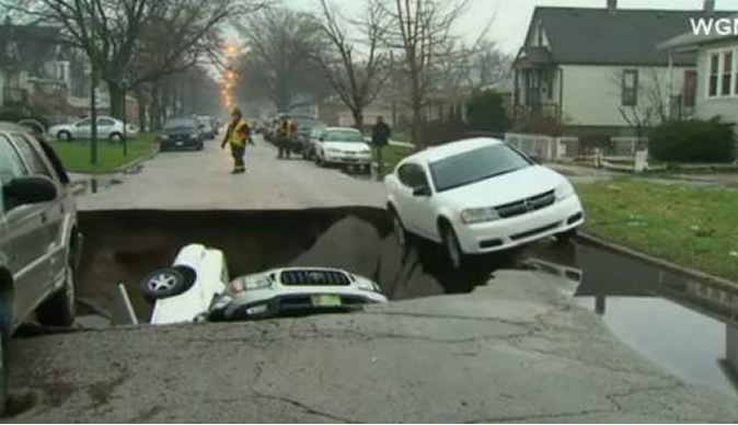 Sinkhole swallows three cars
