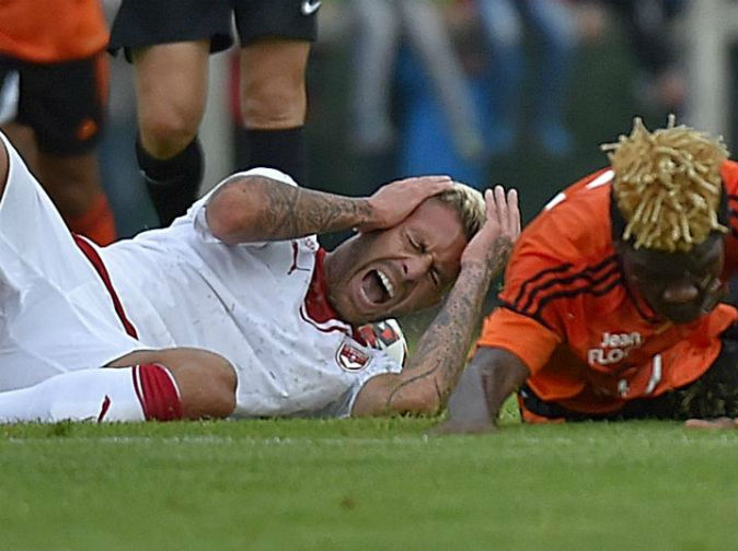 Footballer loses part of ear in injury during match