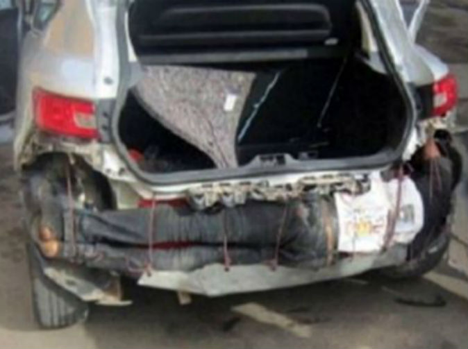 Man found hidden in smuggler's car bumper
