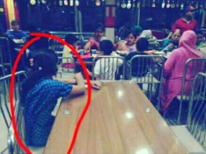 Wealthy family 'forced maid to sit and watch them eat at separate table'