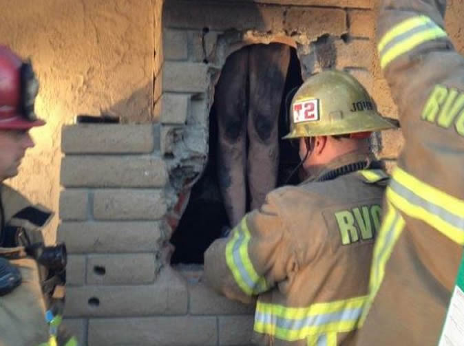 Woman takes off all clothes, climbs ex lover's chimney and gets stuck