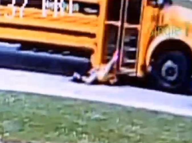 School girl dragged along road by bus (video)