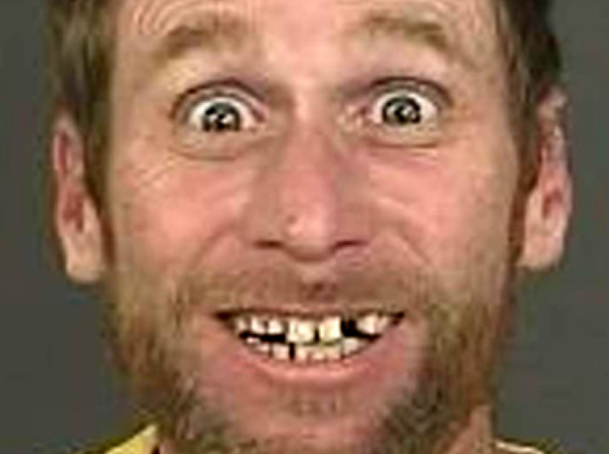 Thief 'wins' title for 'world's happiest mugshot'