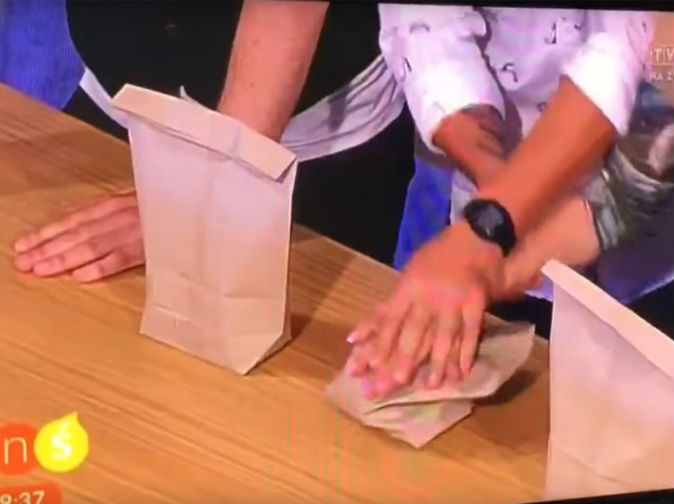 Magician stabs presenter's hand during trick on live TV