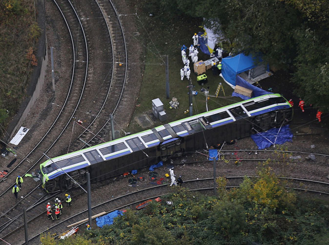 Tram crash driver arrested on suspicion of manslaughter after doing 50 on a 12mph bend