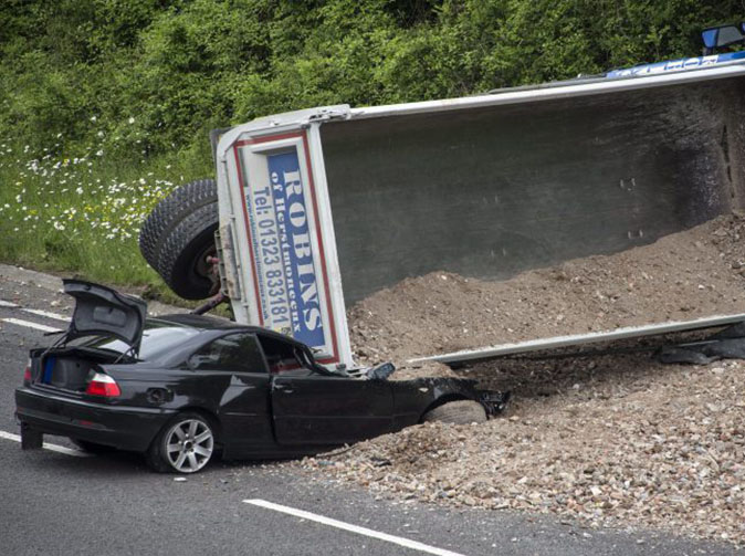 Driver miraculously unharmed after lorry completely crushes his BMW