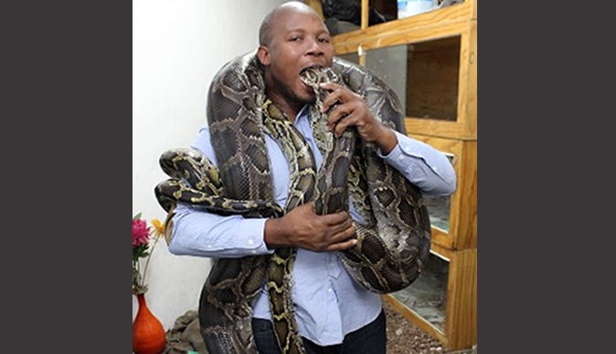 Traditional healer keeps pythons and says they give him power