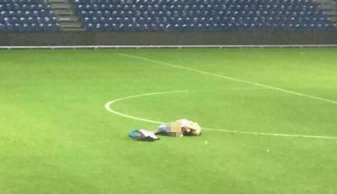 Football fans caught having sex in middle of the pitch