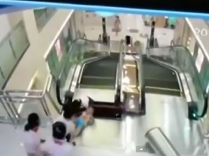 Mother throws son to safety before being swallowed up by escalator