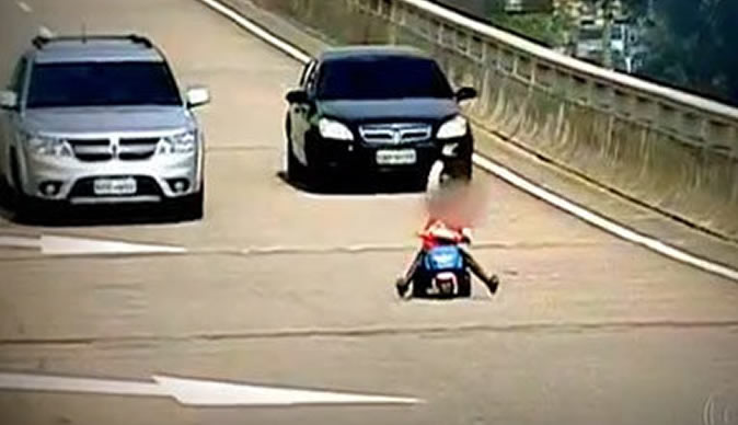 Eight-year-old boy rides tricycle on motorway