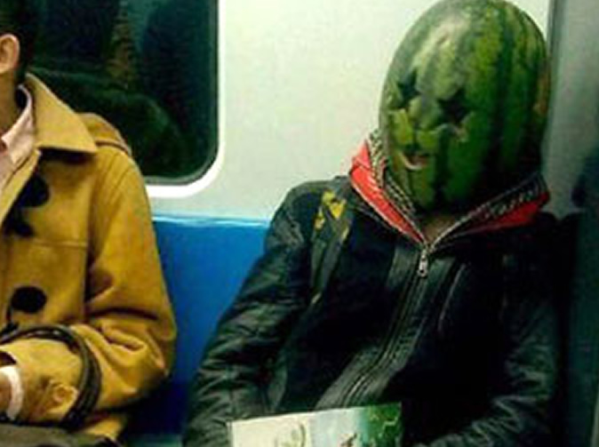 Man with watermelon on his head frightens train passengers