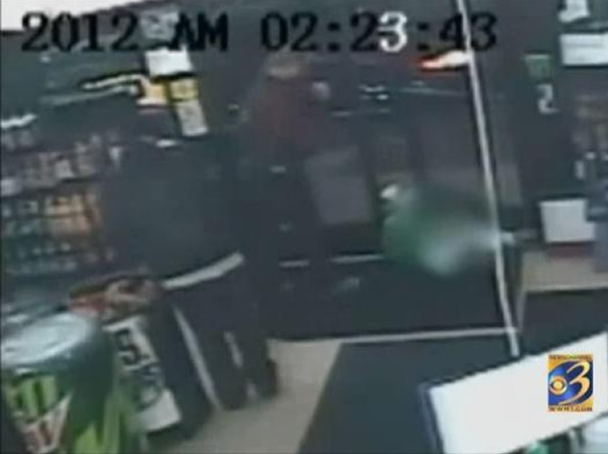 Video shows customers walk over dead body in the doorway